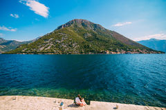 The pair sits on the shore of Kotor Bay, on the island of Gospa od Skrpel Stock Photo
