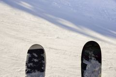 Pair of skis captured at a chairlift looking down onto piste stock photos