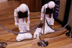A pair of `sleeping` Pepper robots in a shopping mall. Royalty Free Stock Photography