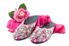 Pair of slippers and silk scarf Stock Photos