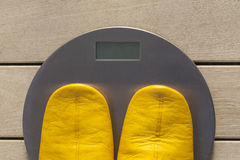 Pair of slippers on the weight scale Stock Photography