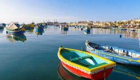 Pair of  small Colored fishing boats, Malta. Colored Fishing boats in  Marsaxlokk harbor, Malta Stock Photos