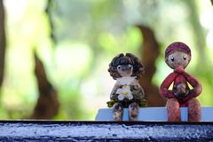 A pair of small dirty boy and girl statues sitting in the garden area royalty free stock photography