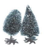 Pair of small plastic christmas trees Royalty Free Stock Photography