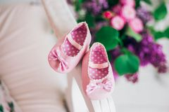 Pair of small sweet new pink shoes royalty free stock photos