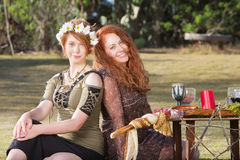 Pair of Smiling Pagan Women Royalty Free Stock Photography