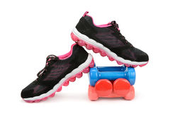Pair of sneakers and dumbbells Stock Image