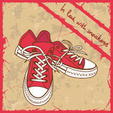 Pair of sneakers on a retro background Royalty Free Stock Images