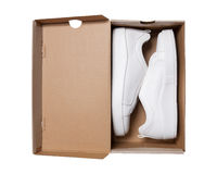 Pair of sneakers in shoe cardboard box isolated on white backgro Royalty Free Stock Image