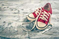 Pair of sneakers. On wooden background with empty space stock photo