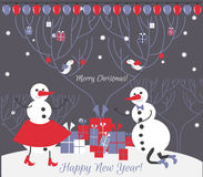 A pair of snowman with Christmas gifts. Christmas card. Merry Christmas! Happy New Year Royalty Free Stock Photos