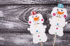 Pair of snowmen with space for text. Sweet snowmen from marshmallow. Cheerful sweets for Christmas tree royalty free stock image