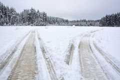 A pair of Snowmobile tracks Royalty Free Stock Photography
