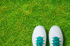 Pair Of Soccer Shoes On green grass field Stock Image