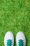 Pair Of Soccer Shoes On green grass field Stock Photo