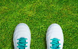 Pair Of Soccer Shoes On green grass field Stock Images