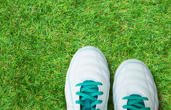 Pair Of Soccer Shoes On green grass field Royalty Free Stock Image