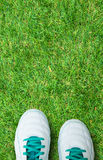 Pair Of Soccer Shoes On green grass field Stock Photography