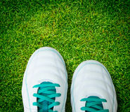 Pair Of Soccer Shoes On green grass field Royalty Free Stock Photography