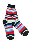 Pair of socks. A pair of colorful striped socks isolated on white background stock photography