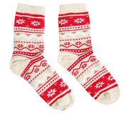 Pair socks winter holiday ornaments isolated. Pair socks with red winter holiday ornaments isolated royalty free stock photography