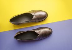 Pair of female shoes on yellow background stock photo