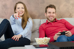 Pair spends free time playing video games. Video game couple leisure play console watching gamepad concept Stock Photography