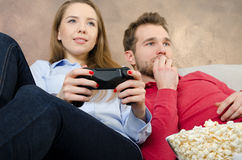 Pair spends free time playing video games. Video game couple leisure play console watching gamepad concept Royalty Free Stock Photography
