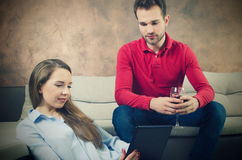 Pair spends free time. Woman with a tablet in hands Royalty Free Stock Images