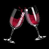 Pair of splashing wine glass. On black background isolated Stock Images