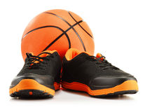 Pair of sport shoes and basketball on white Royalty Free Stock Photos