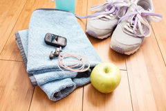 Pair of sport shoes and fitness accessories. Stock Photography