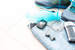 Pair of sport shoes and fitness accessories. Stock Image