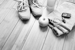 Pair of sport shoes and fitness accessories. Royalty Free Stock Photos