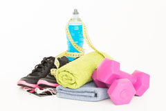 Pair of sport shoes and fitness accessories on white. Stock Photos