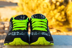 Pair of sport shoes outdoors. Horizontal composition Stock Photos