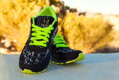 Pair of sport shoes outdoors. Horizontal composition Stock Photography