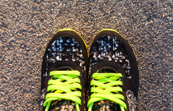 Pair of sport shoes outdoors. Horizontal composition Royalty Free Stock Photos