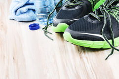 Pair of sport shoes and water bottle. After workout setting Stock Photo