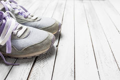 Pair of sport shoes on white wood Royalty Free Stock Image