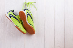 Pair of sport shoes on a white wooden wall Stock Photos