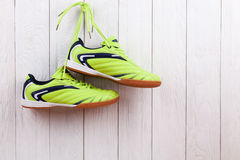 Pair of sport shoes on a white wooden wall Royalty Free Stock Photography