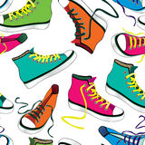Pair of sport sneakers seamless pattern. Hand drawn stylish  Royalty Free Stock Photo