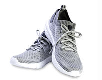 Pair sport textile trainers shoes summer design. Pair grey summer textile men& x27;s sport shoes . Athletic trainers Royalty Free Stock Photography