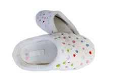 Pair of spotty slippers. Old worn slippers with colorful spots Stock Photo