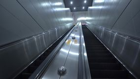 A pair of stairs to the underground metro, it consisting of grey metal surfaces and grey walls.  stock video