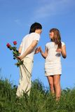 Pair Stands, Guy Holds Behind Back Bouquet Royalty Free Stock Photography