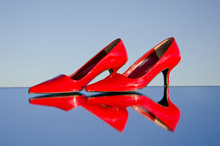 A pair of stiletto on mirror Stock Image