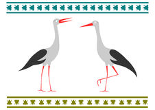 Storks. A pair of storks in a folk style on a white background Stock Images