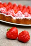 A pair of strawberries  with a strawberry cake in Stock Images